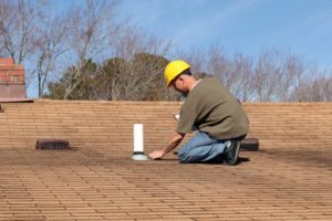How to Handle a Roof Leak While Waiting for Help